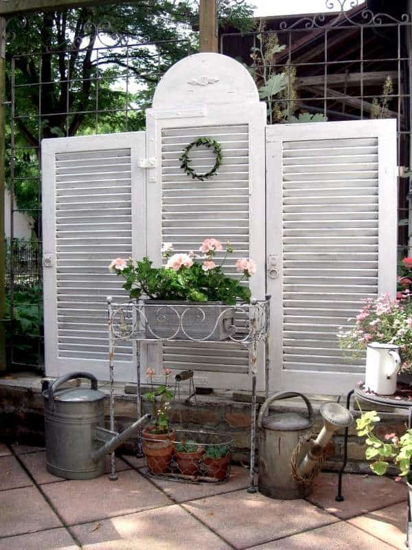 Creating Whimsy In Your Backyard & Garden, Part One. A clever louvered set of shutters as a privacy backdrop for patio or garden