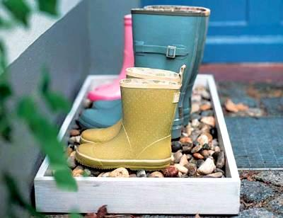 A muddy boot holder, a DIY entryway project