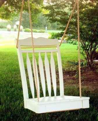 A white backyard chair swing