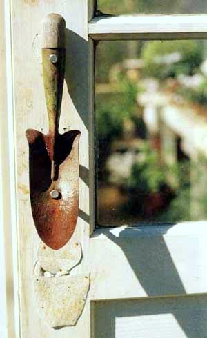A shabby chic door pull made out of a trowel