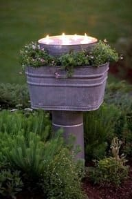 Creating Whimsy In Your Backyard & Garden, Part Two. Pathway lights out of an old washtub with candles in garden