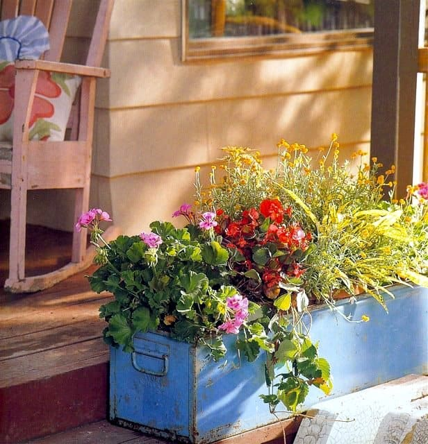 Creating Whimsy In Your Backyard & Garden, Part One. An old blue toolbox planter, vintage metal flower planter