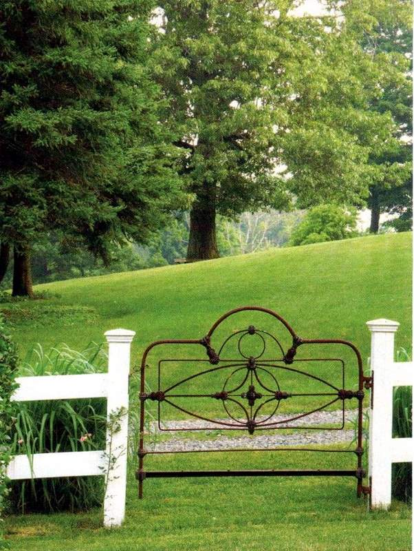 Creating Whimsy In Your Backyard & Garden, Part Two. An old metal headboard,of a bed used as garden gate