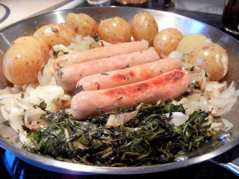 Cooking greens with sausage, onions and greens