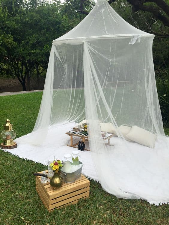 mosquito netting over an outdoor conversation area