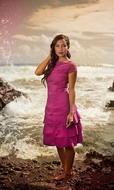 A shabby apple aloha dress in hot pink on a lady on the beach