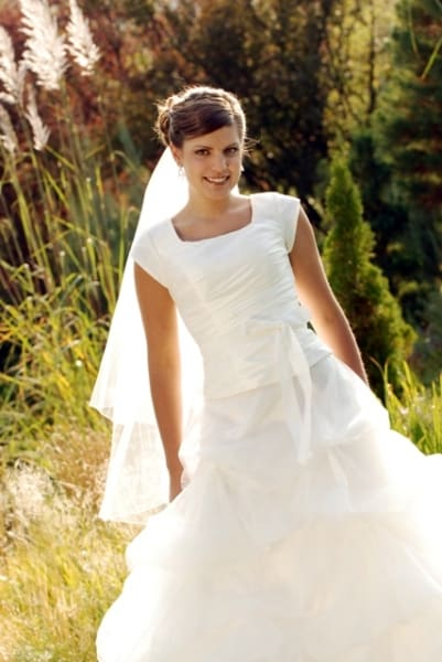 From Church To Wedding To Black Tie Event: Getting Dressy. A graceful bride in her wedding dress.
