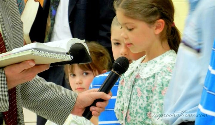 Memorizing Scripture Promises Highest Rate Of Return On Effort, little girl speaking into a microphone, man holding microphone for daughter