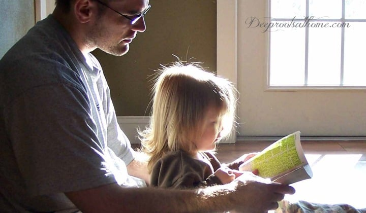The Father/Daughter Relationship & What a Mom Can Do to Facilitate It. A father reading the Bible to his daughter
