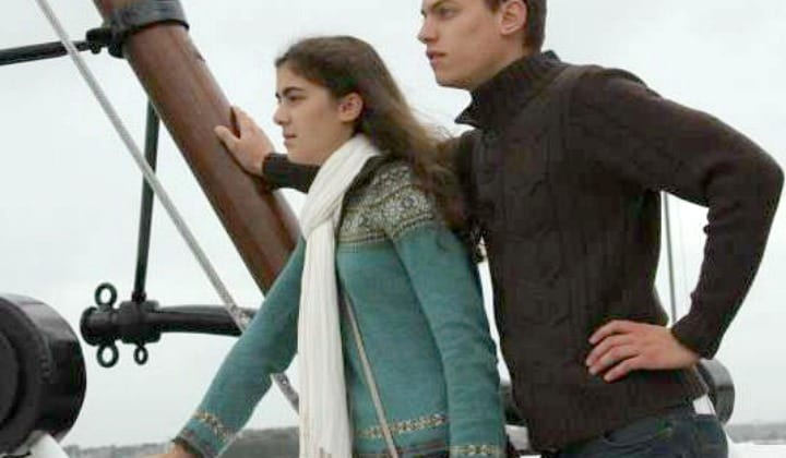 A Big Picture View Of Modern Feminine Dress: First Installment. A man and woman in classic cardigans on a ship