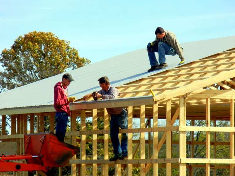 Moldable Boys: Raise Them to be Competent, Hard-Working & Masculine. Putting on a new roof... father and sons working construction
