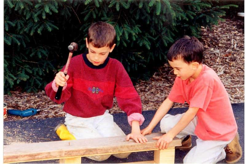 Moldable Boys: Raise Them to be Competent, Hard-Working & Masculine. Two brothers building with hammer and nails