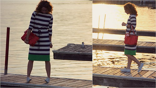 In deck shoes and striped cotton boat-neck dress, out on the lake