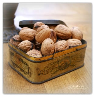 Simply Classic & Timeless Natural Holiday Decorations. walnuts, antique tins