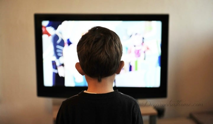 Television: Stunting the Development of Our Children's Brains. a kid watching TV