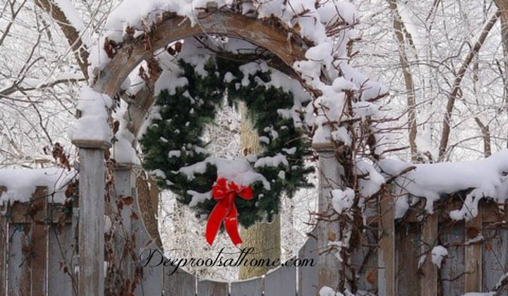 Simply Classic & Timeless Natural Holiday Decorations. A garden archway with Christmas wreath