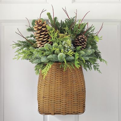 Simply Classic & Timeless Natural Holiday Decorations. pine boughs in a wicker basket for door