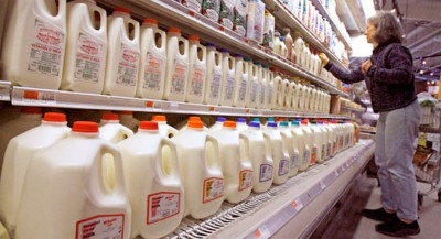 Which Is Worse: White Refined Sugar or the Additive Aspartame? Gallons and cartons of milk on the grocery store shelf.