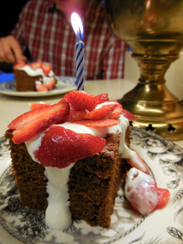 Chocolate Birthday cake with icing and fresh strawberries