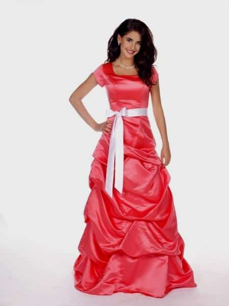 From Church To Wedding To Black Tie Event: Getting Dressy. A satin prom dress in watermelon.