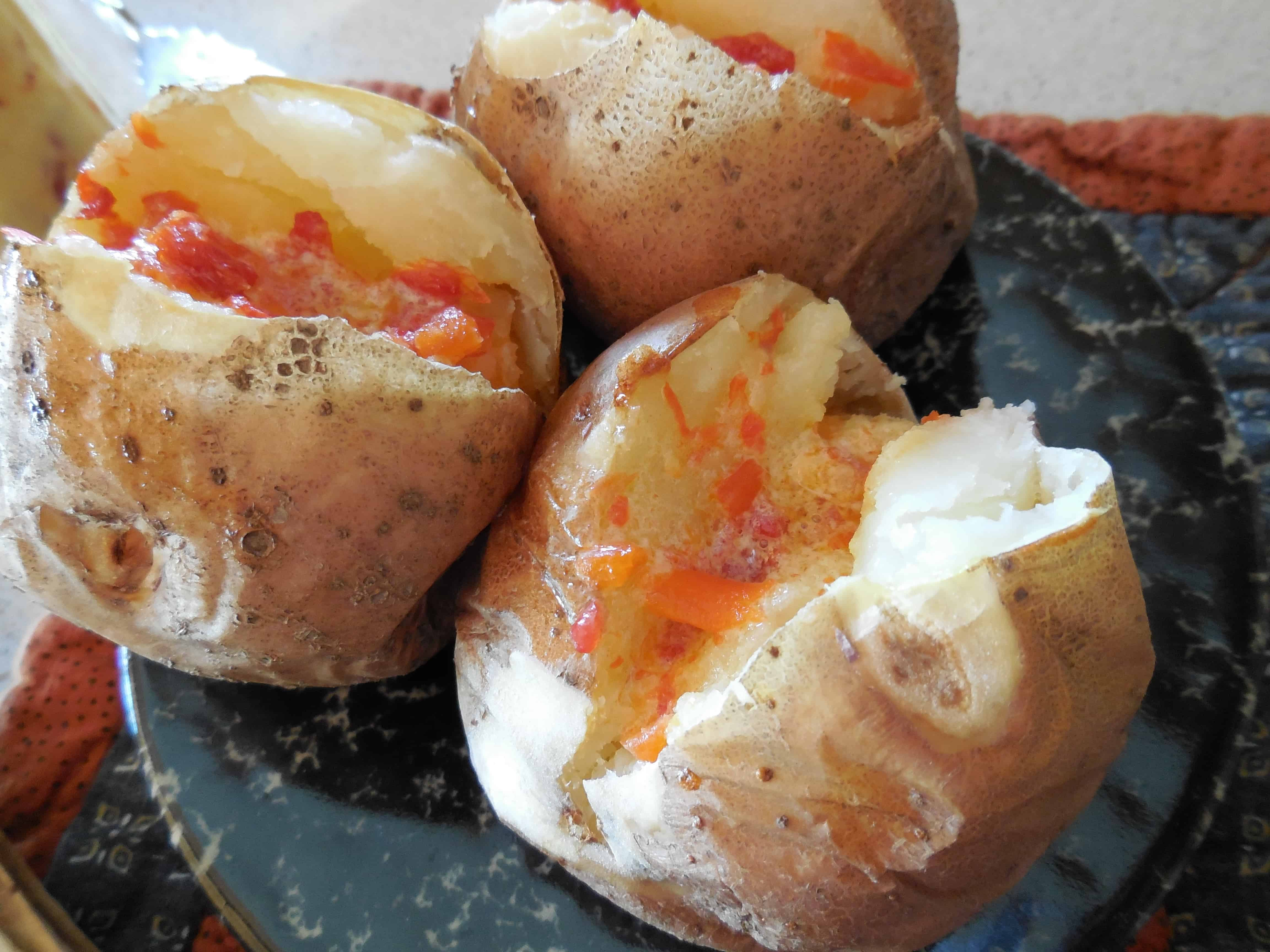 Roasted Red Pepper Butter Recipe: Comfort Food, Easy, Ketogenic. Image of it melting on baked potatoes.