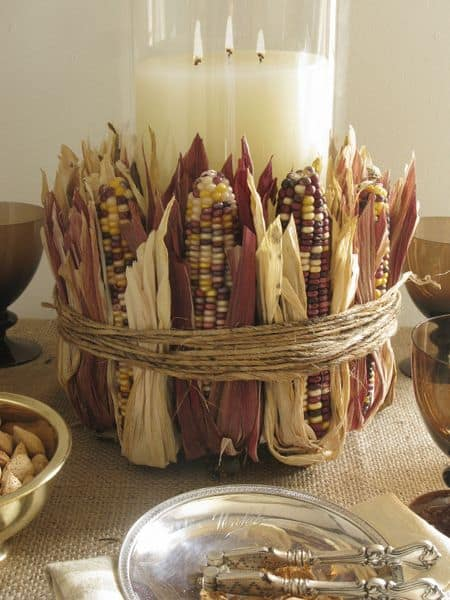 18 Classy, Natural Elements for Fabulous Fall Decor & Color. A table-setting with candles and a gathered Corn Cob Display,