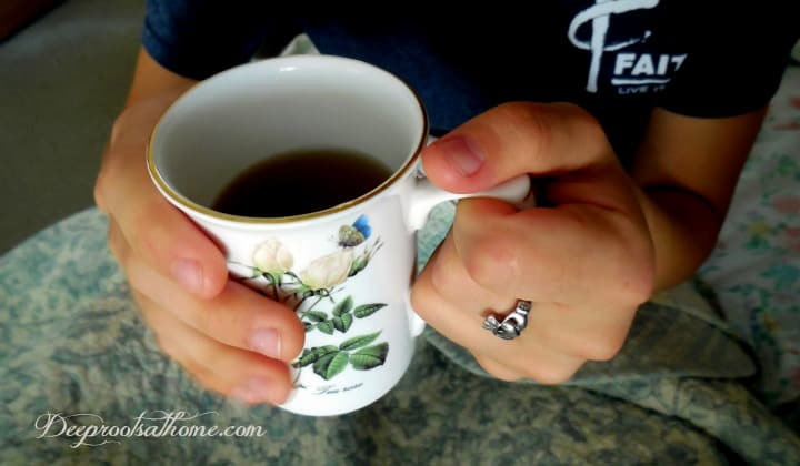 Discover No-Side-Effect Migraine Remedy. My daughter holding an old-time remedy of feverfew and lemon balm in hot tea.