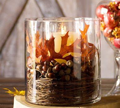 18 Classy, Natural Elements for Fabulous Fall Decor & Color. Large side glass vase holding nature's bounty and central candle