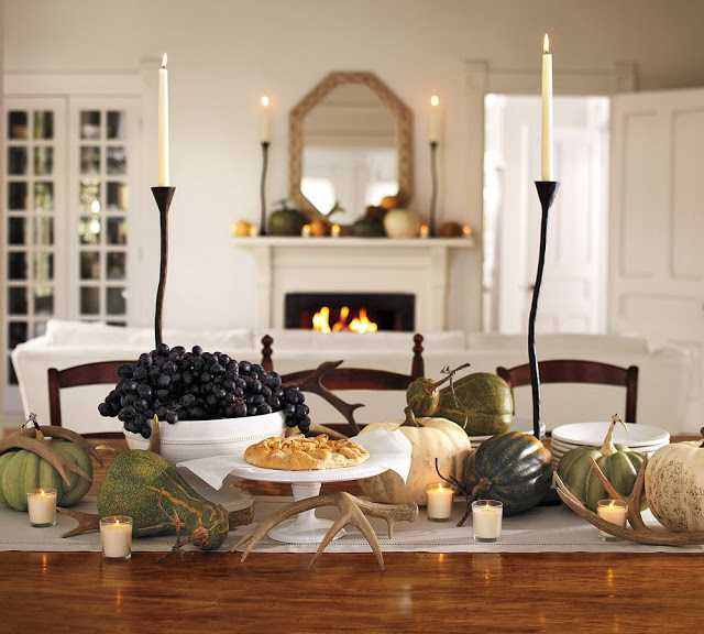 18 Classy, Natural Elements for Fabulous Fall Decor & Color. A Martha Stewart table-setting with wrought iron candles, large gourds and antlers.
