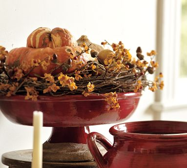 18 Classy, Natural Elements for Fabulous Fall Decor & Color. A Pottery Barn bowl of grapevine, gourds, and bittersweet vine.