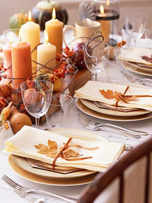 18 Classy, Natural Elements for Fabulous Fall Decor & Color. A table-setting with candles, gourds, Indiana corn, corn cob, seeds,
