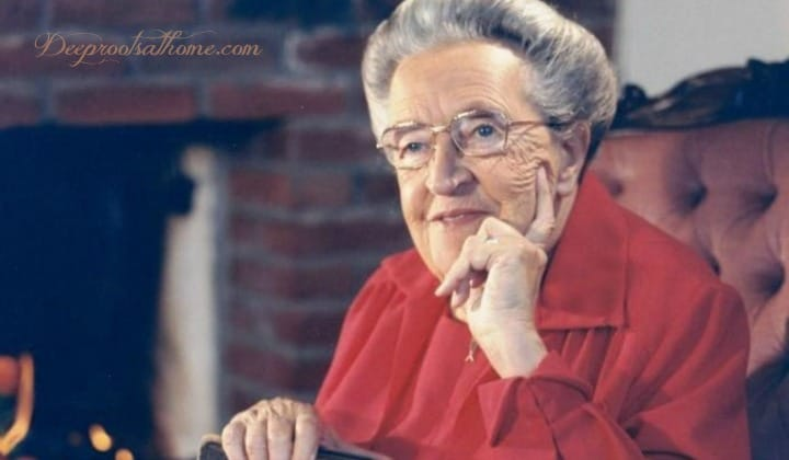 Revisiting Corrie's Christmas Memories of Christmases Past. Corrie ten Boom in a red Christmas dress.