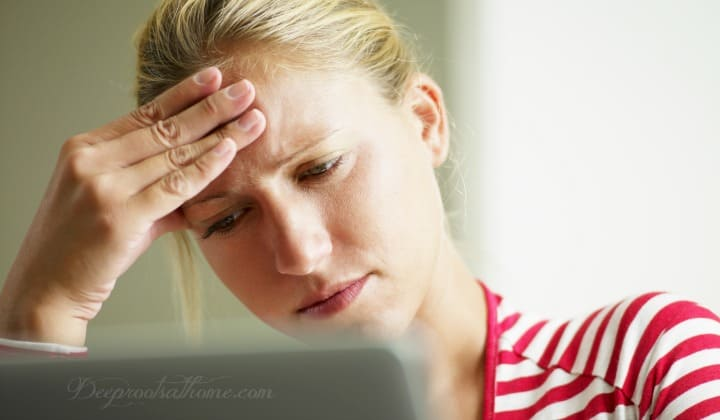 14 No-Side-Effect Remedies. A woman with an obvious headache on her computer