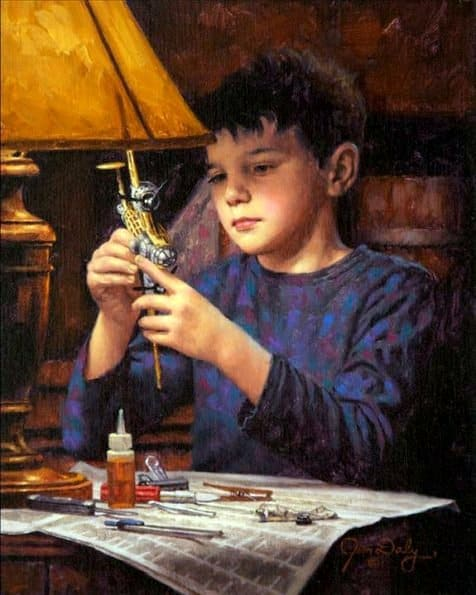 Are We Starving The Hearts Of Our Children? a older boy building model airplane