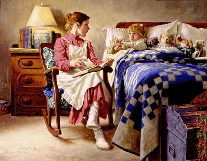 mother reading to her daughter going to bed