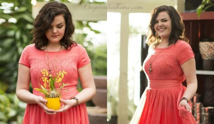 The Plus Size Woman: Put-Together, Attractive, Feminine Dressing, A young woman, elegantly curved, in a classy coral summertime dress.