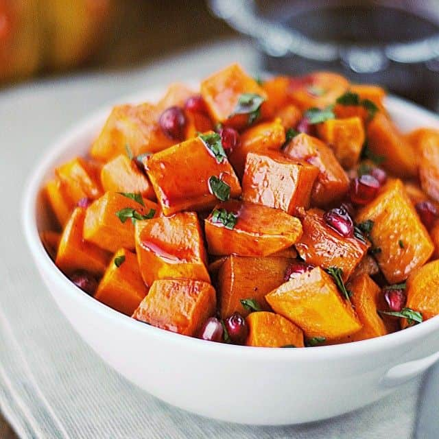 29 Festive Pomegranate Recipes & De-Seeding Video. Roasted Sweet Potatoes with Spiced Pomegranate Molasses {That's Some Good Cookin'}
