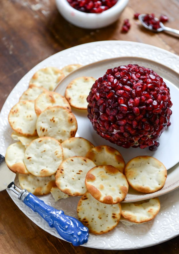 29 Festive Pomegranate Recipes & De-Seeding Video. Pomegranate-Jeweled White Cheddar, Toasted Almond, and Crispy Sage Cheese Ball  {How Sweet It Is}