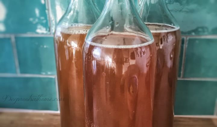 A Complete Beginner's Guide To Brewing Your Own Kombucha. 3 bottles of kombucha ready to refrigerate.