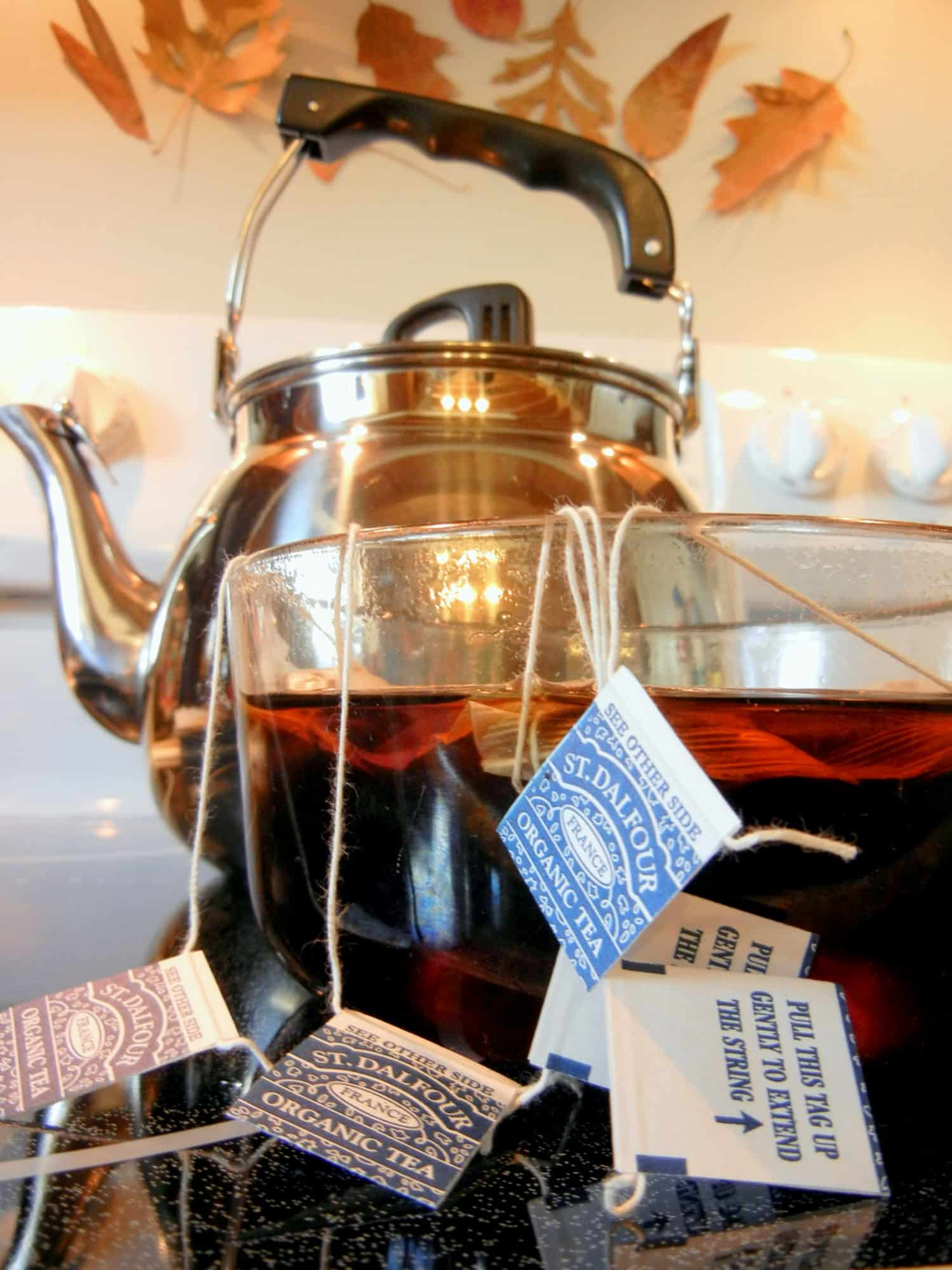 A Complete Beginner's Guide To Brewing Your Own Kombucha. steeping tea bags in boiling water