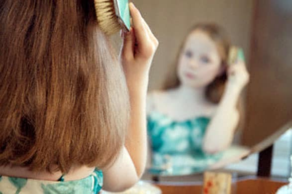 Plastics Messin' With The Hormones Of Our Children? brushing hair, young girl