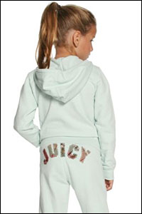 A young girl in sweats with the word 'juicy' on her bottom