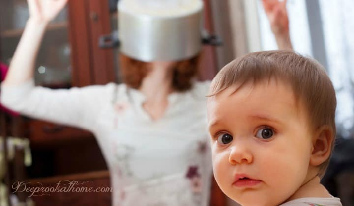 9 Facts About Wireless & Your Child's Brain. A distraught mother in the kitchen with a pot over her head and a cute baby looking at the camera