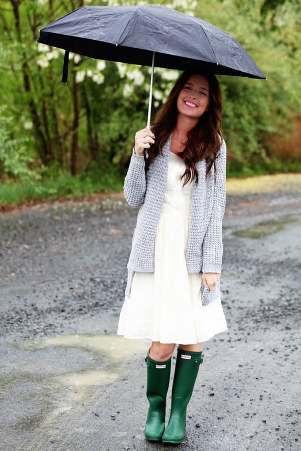 25 Classic Ladylike Looks For You: Spring Heading Into Summer. woman in the rain with galoshes and an umbrella