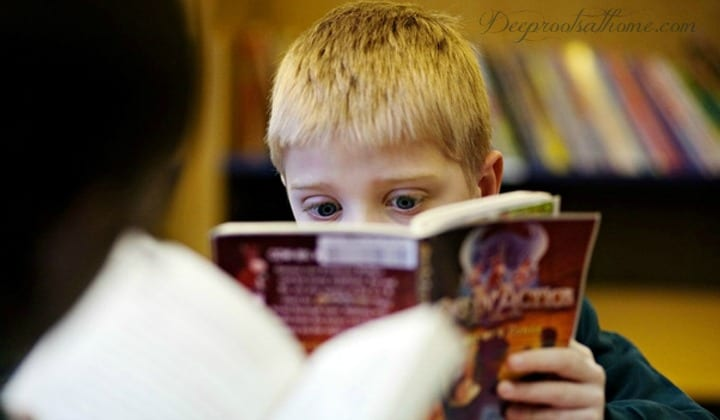 Books Unhealthy For Children {Recent Newbery, Caldecott & YA}, a young boy obviously shocked by what he is reading!