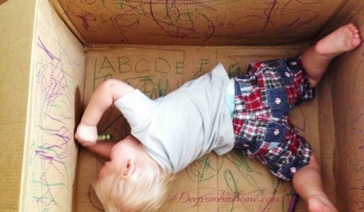 Does Your Child Have Time to Play? Just...Play? A happy and entertained child playing alone with markers in a cardboard box.