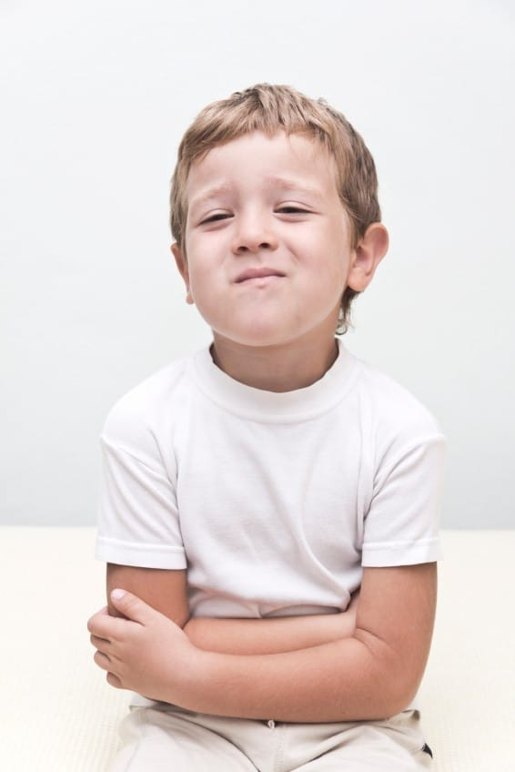 Rethink Medicating: Help Kid's Focus, Sensory, or Behavioral Issues A handsome young boy with a stomach ache