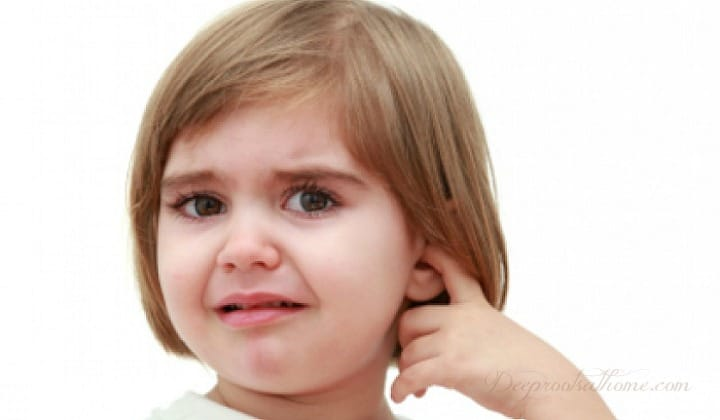 Chiropractic Found Better Than Drugs for Children's Ear Infections, a little girl whose ear is obviously hurting.