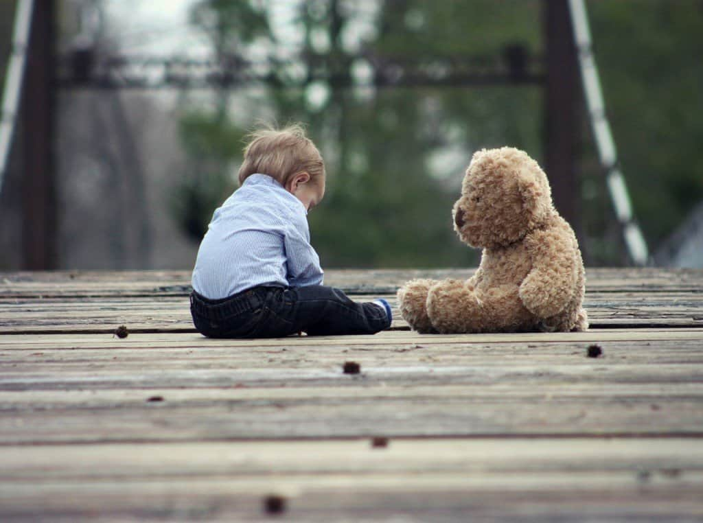 Boys Think and Process Differently Than Girls. Boys Think, See, Hear & Process Very Differently Than Girls. A cute boy and teddy bear sitting on the bridge