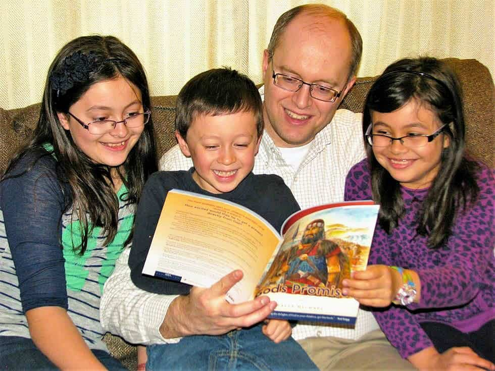 Teach The Whole Counsel of God: Don't Just Teach Bible Stories. parent reading 'God's Promises' to children